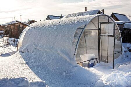 tunes: Greenhouse polycarbonate unit tunes snow.  Russia, Siberia, Novosibirsk region