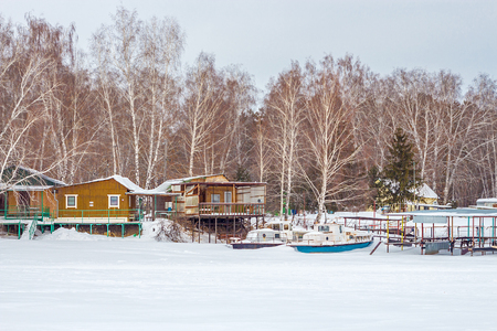 The river Split the Town of Berdsk, Novosibirsk oblast, Siberia, Russia - January 12, 2017: the snowy river and boat station