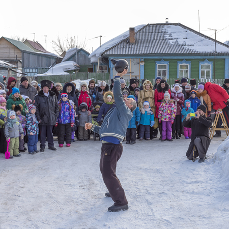 Berdsk, Novosibirsk oblast, Siberia, Russia - February 26, 2017: Russian holiday of farewell to winter. Submission - lifting exercises with weights Editorial