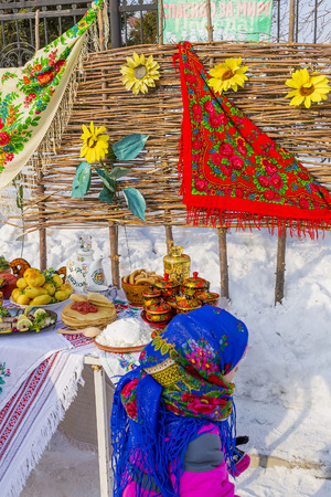 Berdsk, Novosibirsk oblast, Siberia, Russia - February 26, 2017: the table was laid with food on the street, in the carnival holiday