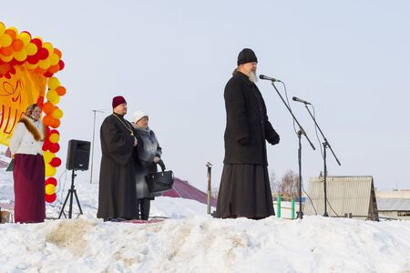 the abbot: Berdsk, Novosibirsk oblast, Siberia, Russia - February 26, 2017: the Abbot Berd Candlemas parish father Vasily in a speech at the celebration of Maslenitsa