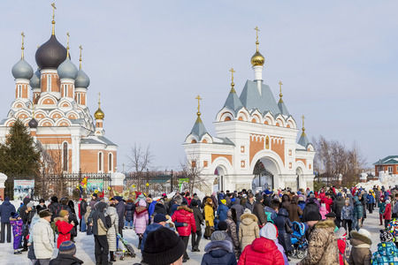 Berdsk, Novosibirsk oblast, Siberia, Russia - February 26, 2017: Russian holiday of Maslenitsa, national street festivities at the Church