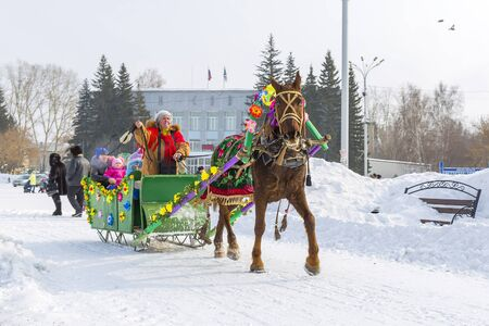 horse sleigh: Berdsk, Novosibirsk oblast, Siberia, Russia - February 26, 2017: horseback riding in the sleigh. The Holiday Of Maslenitsa