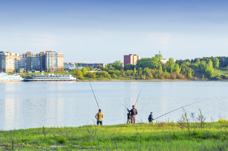 Berdskiy Bay, river Ave, Berdsk, Novosibirsk oblast, Siberia, Russia - may 14, 2017: a Group of young fishermen fishing in the Gulf of Berdsk