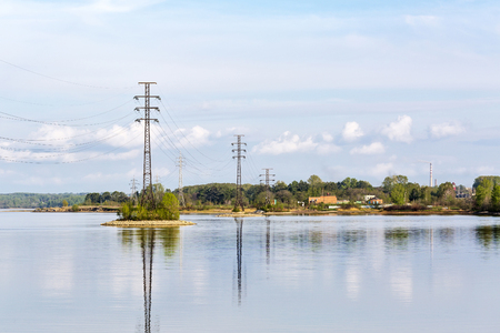 The supports of overhead power lines installed in the river. The river Berd, Berdsk, Novosibirsk oblast, Siberia, Russia Stock Photo