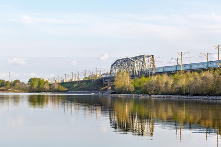 River Ave, city of Berdsk, Novosibirsk oblast, Siberia, Russia - may 14, 2017: view of the railway bridge over the river