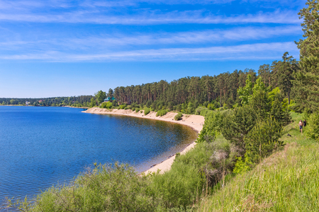 a bathing place: The confluence of the Ob and Berd, Berdsk, Novosibirsk oblast, Siberia, Russia - June 4, 2017: the beach with the tourists on the river