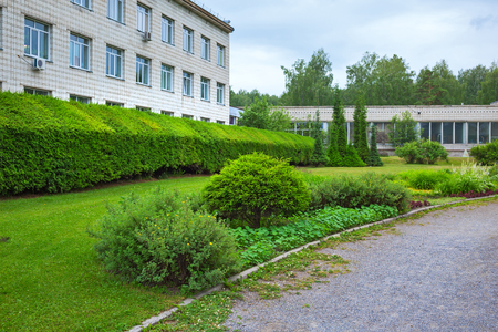 The territory of the Central Siberian Botanical garden, Novosibirsk, Siberia, Russia - June 25, 2017: the administrative building and the grounds landscaped Stok Fotoğraf - 81398048