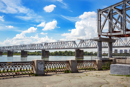 Novosibirsk, Siberia, Russia - July 17, 2017: the railway bridge at the intersection of the mainline of the TRANS-Siberian railway and the Ob ( on the old site ). View of the waterfront