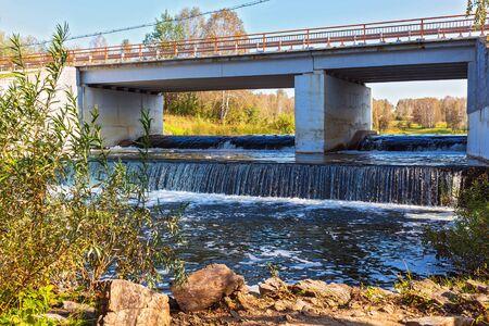 Road bridge over the river Suenga with a waterfall. Maslyaninsky district, Novosibirsk oblast, Siberia, Russia