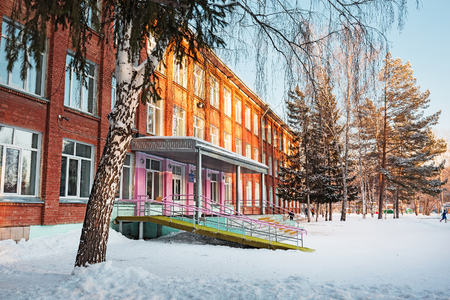 Berdsk, Novosibirsk oblast, Siberia, Russia - December 16, 2017: Municipal budget educational institution secondary school № 11, built in 1965. Old brick building in winter
