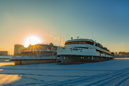 Berdskiy Bay, river Ave, Berdsk, Novosibirsk oblast, Siberia, Russia - January 2, 2018: the double-decked Passenger river ship Viktor Gashkov at the winter Parking lot at the pier