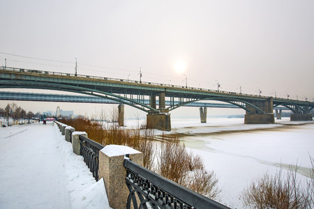 Novosibirsk, Siberia, Russia - Feb 4, 2018: indoor Novosibirsk metro bridge and October bridge over the Ob river in winter