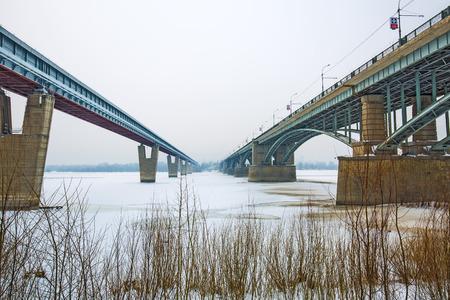 Novosibirsk, Siberia, Russia - Feb 4, 2018: indoor Novosibirsk metro bridge and October bridge over the Ob river in winter