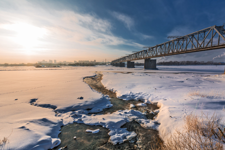 Novosibirsk, Western Siberia, Russia-January 2, 2019: Railway bridge at the intersection of the main course of the TRANS-Siberian railway with the Ob river, view from the Mikhailovskaya embankment