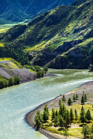 The confluence of the rivers Chuya and Katun surrounded by mountain ranges - Chui-Ooz. Ongudai district, Altai Republic, Russia Stock Photo - 128195335