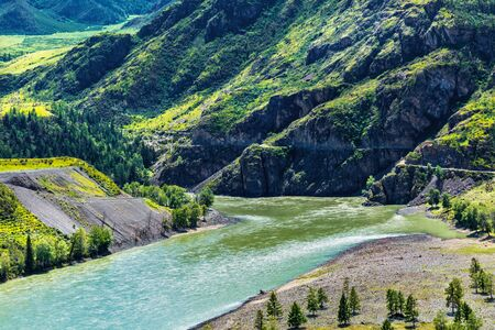 The confluence of the rivers Chuya and Katun surrounded by mountain ranges - Chui-Ooz. Ongudai district, Altai Republic, Russia Stock Photo - 128195334