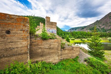 Ulagan municipal district, Altai Republic, South Siberia, Russia - July 13, 2019: unfinished, abandoned Chui (Aktash) hydroelectric power plant on the Chui river