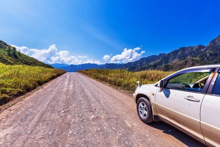 Chemalsky district, Altai Republic, southern Siberia, Russia-August 14, 2019: Passenger car on a gravel road of Chemalsky tract in a mountainous area