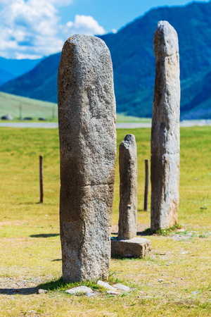 Near the village of yinya, Ongudai district, Altai Republic, Russia - July 15, 2019: ancient stone stellae - cult objects of the bronze age