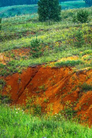 Output of natural clay of red shades. Lushniki village, Novosibirsk oblast, Western Siberia, Russia