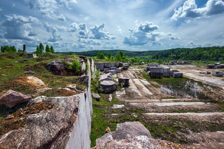 Quarry for the extraction of natural pink marble. Peteni village, Maslyaninsky district, Novosibirsk region, Western Siberia, Russia Archivio Fotografico