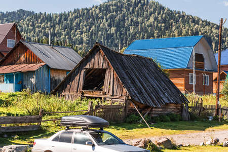 Artybash village, Turochaksky district, Altai Republic, Russia-August 20, 2020: private buildings on the shore of lake Teletskoye