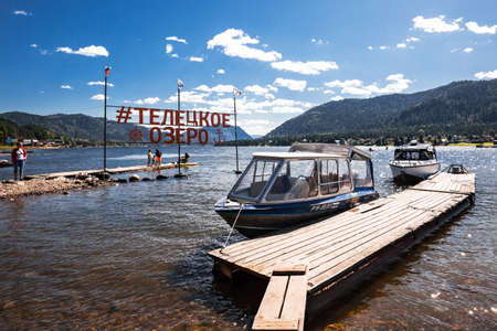 Artybash village, Turochaksky district, Altai Republic, Russia-August 20, 2020: Pier and pleasure boats in the village of Artybash on lake Teletskoye