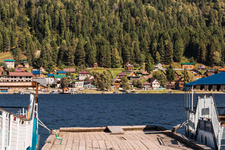 Iogach village, Turochaksky district, Altai Republic, Russia-August 20, 2020: View from the pier in the village of iogach to the village of Artybash