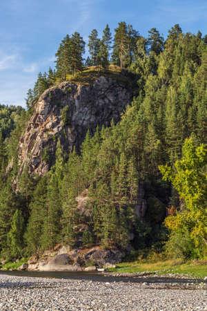 Stone cliff near the BII river near the village of Turochak. Turochaksky district, Altai Republic, South of Western Siberia, Russia