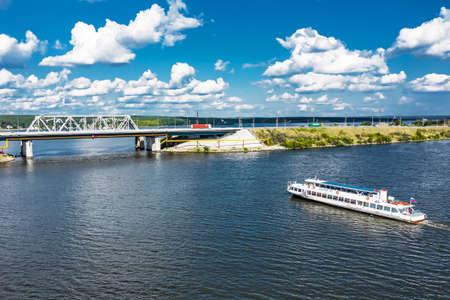 BERDSK, Novosibirsk Region, Western Siberia of Russia - July 28, 2021: Highway and railway bridge over the Berd River in summer Sajtókép