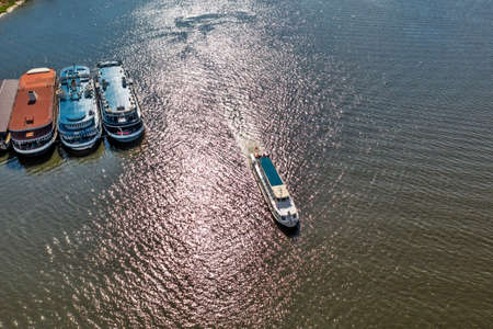 BERDSK, Novosibirsk Region, Western Siberia of Russia - July 28, 2021: A bird's-eye view of a pleasure boat in the waters of the Ob Sea