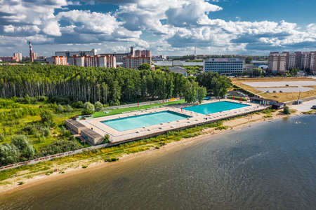 BERDSK, Novosibirsk Region, Western Siberia of Russia - July 28, 2021: Bird's-eye view of the outdoor pool and Remix Beach on the shore of the Ob Sea Sajtókép