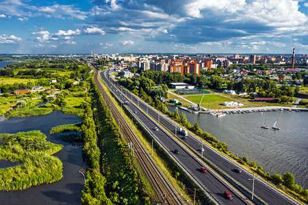 BERDSK, Novosibirsk Region, Western Siberia of Russia - July 28, 2021: Highway and railway tracks near the Berd River in summer Sajtókép