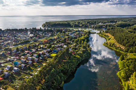 A bird's-eye view of the mouth of the Razdelnaya River, which flows into the Ob Sea. Berdsk, Novosibirsk region, Western Siberia of Russia