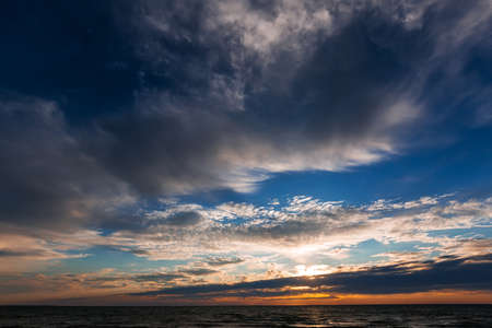 The setting sun and the sky over the Ob Sea. Novosibirsk Region, Western Siberia of Russia