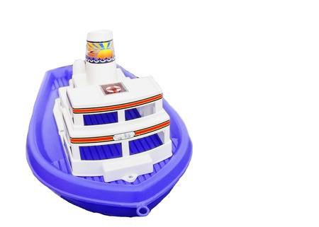 pictured in the photo beautiful children toy plastic ship blue and white Foto de archivo