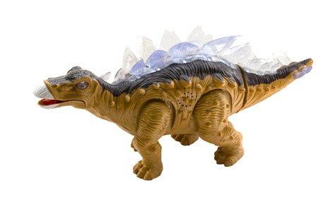pictured in the photo A stegosaurus toy isolated on a white background. Stock Photo