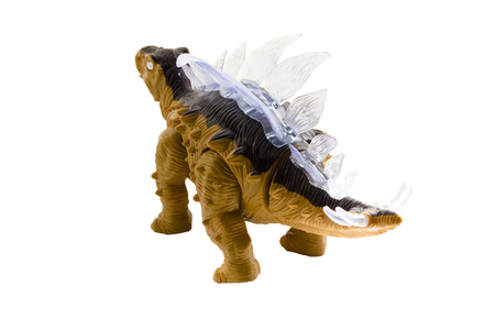 A stegosaurus toy isolated on a white background.