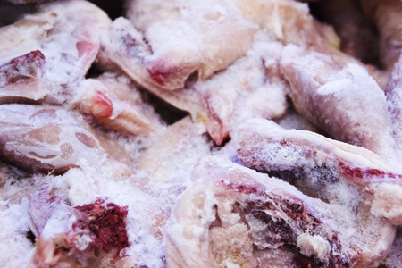 pictured in the photo Frozen raw chicken, background