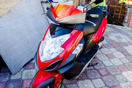 Closeup of red motorcycle. Beautiful modern red motorcycle 写真素材