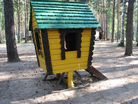 pictured in the photo playground in urban park forest with wooden hut and slide