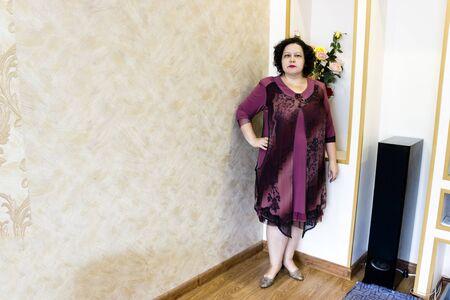 woman in a beautiful evening lilac dress