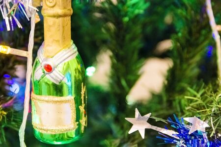 beautiful Christmas toy in the shape of a champagne bottle close- up