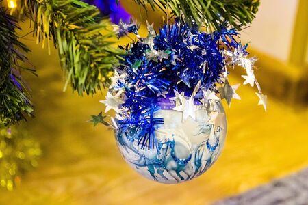 Christmas ball on the tree on blue 写真素材