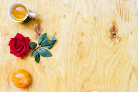 Fresh banana and persimmon in brick wall background and wooden table,