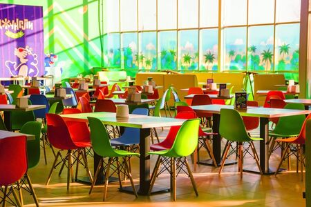 Tables and chairs on food court in huge mall Standard-Bild