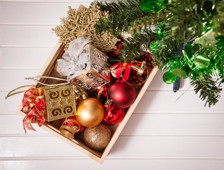 christmas decorations with white background: Box filled with Christmas decorations on white background Stock Photo