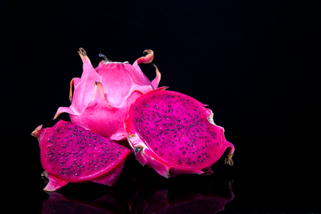 fruit: Fresh red dragon fruit with cut dragon fruit and slice on black background Stock Photo