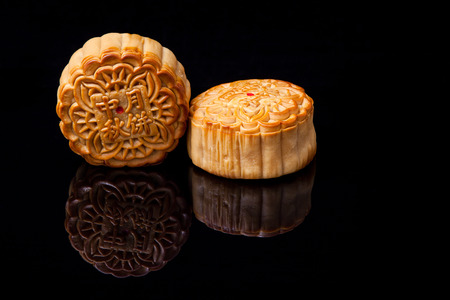 moon cakes for the chinese Mid-Autumn festival on black background